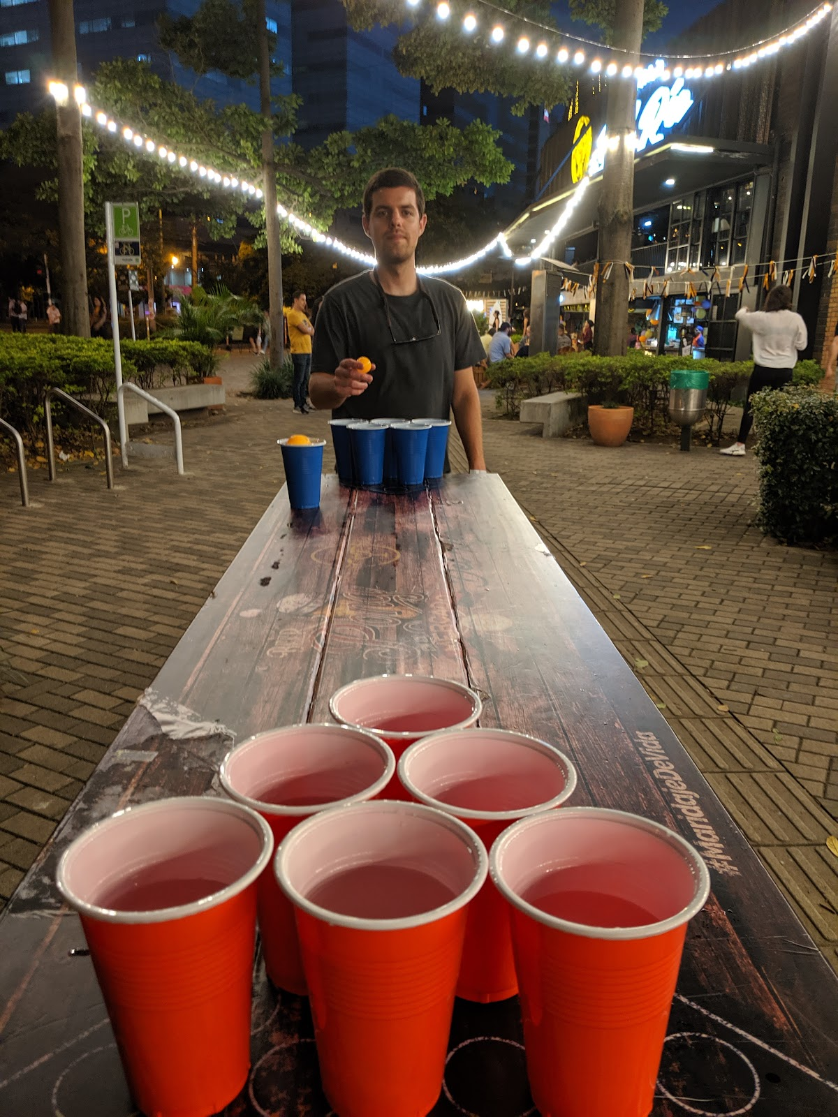Brandon playing pong at Mercado del Río in Medellin, Colombia.