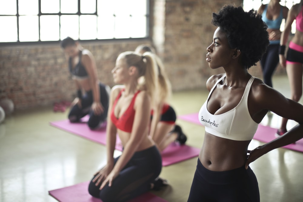 Women all getting ready for a fitness class.