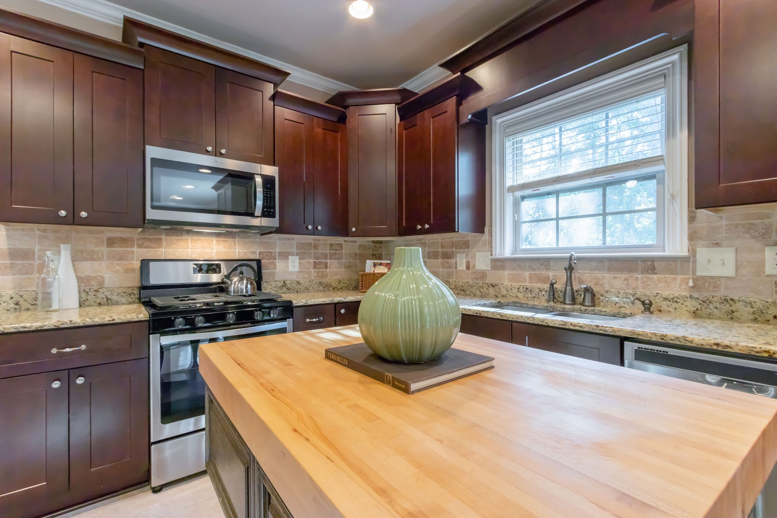 Adding a pop of color is the last step to how to stage your kitchen