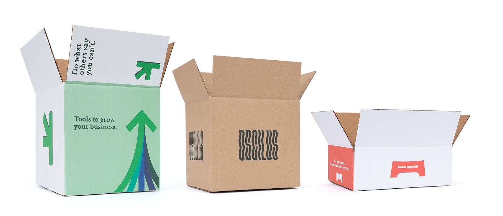 three shipping boxes. 2 white, 1 kraft