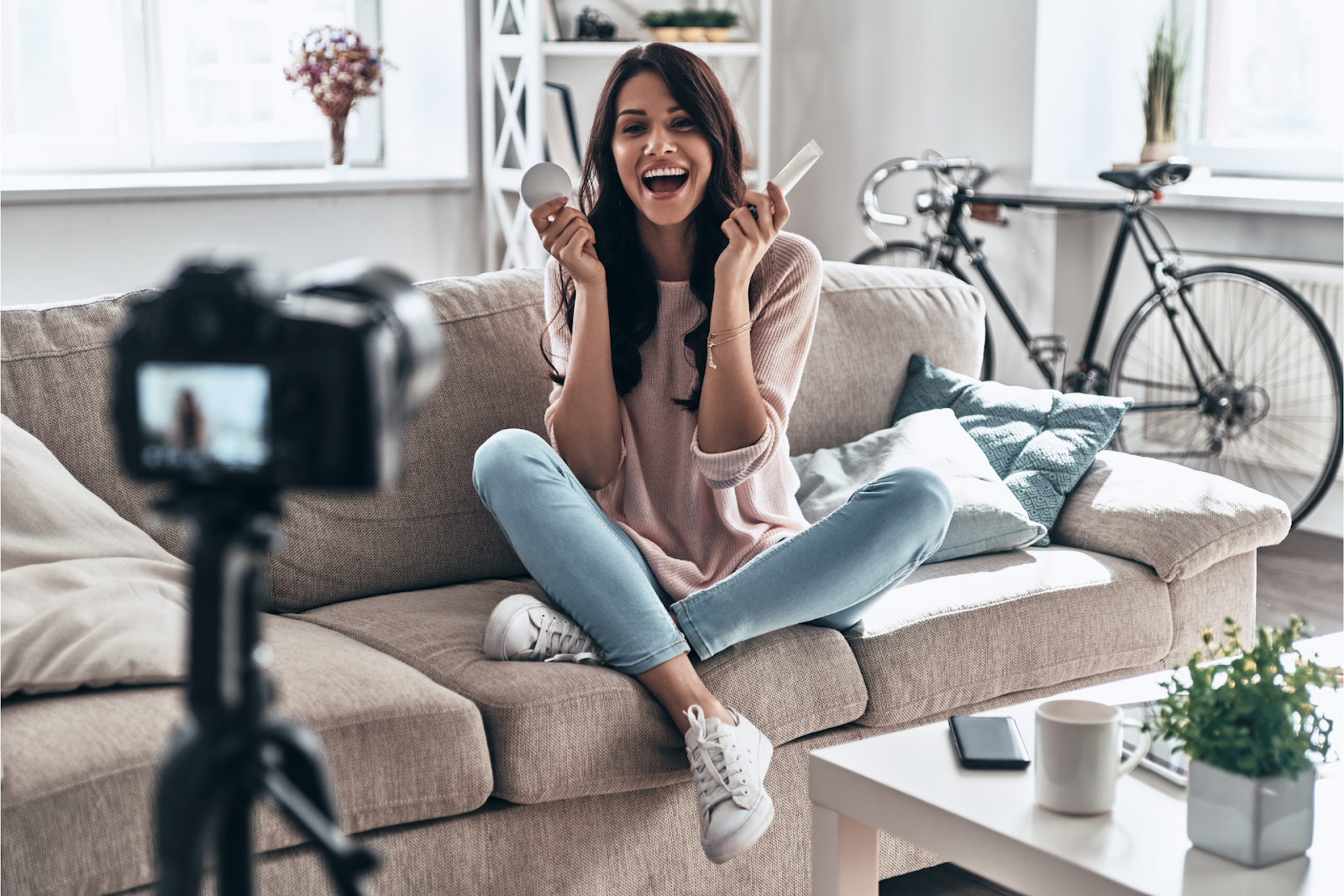 An influencer films a video in her home