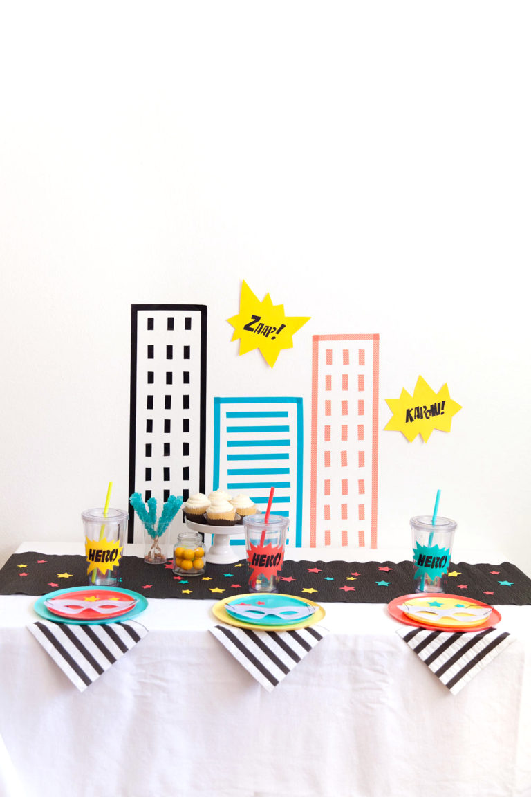 tutorial to create washi tape DIY party backdrops for the best superhero party ever