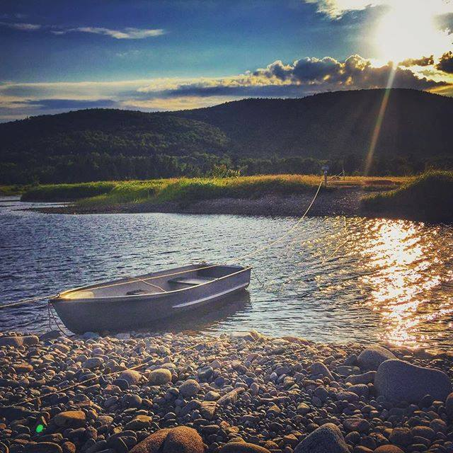 Photo of a Canoe on the Water near Cabot Shores, Home to the Finest Cape Breton Chalets.