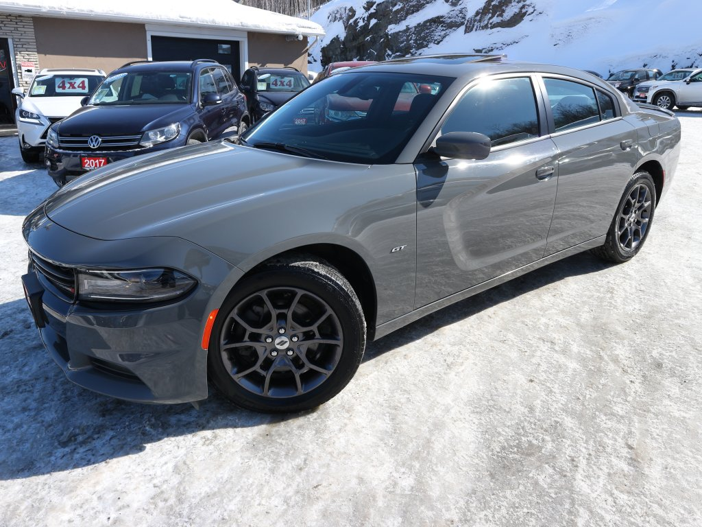 A grey 2018 Dodge Charger sits in the lot of Auto Depot Sudbury