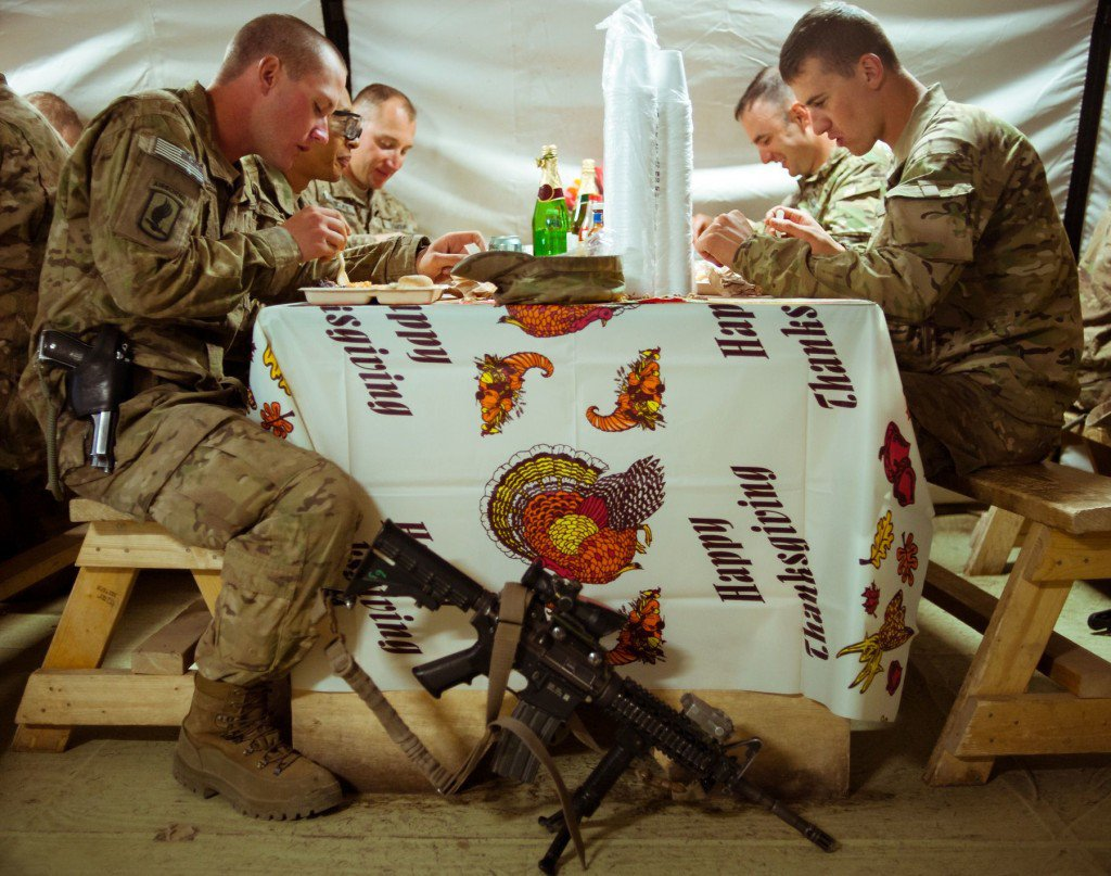Soldiers from the 173rd Airborne Brigade eat a makeshift Thanksgiving at their outpost south of Kabul in 2012.