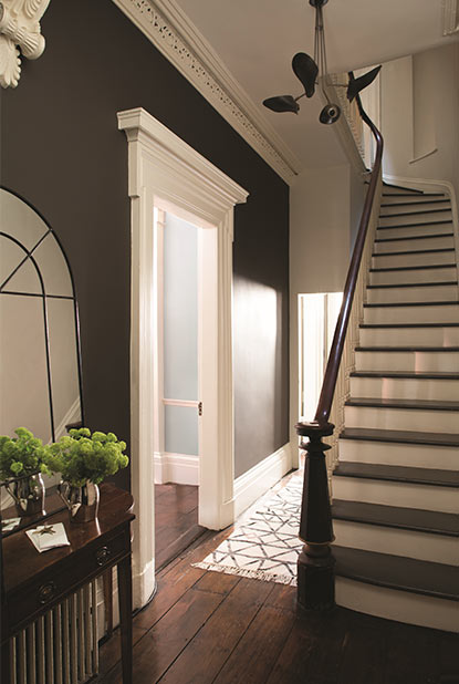 Hallway painted in deep brown paint colour with eggshell finish