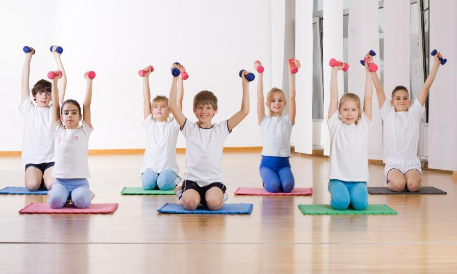 Children doing exercise with weights .