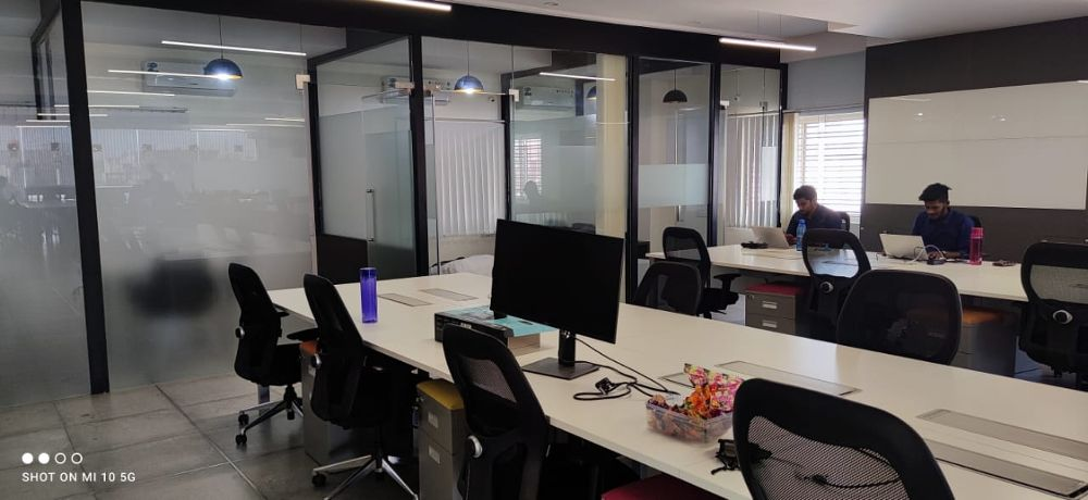 This is a workplace image of Kutumb office. It shows that employees are working on their laptops.