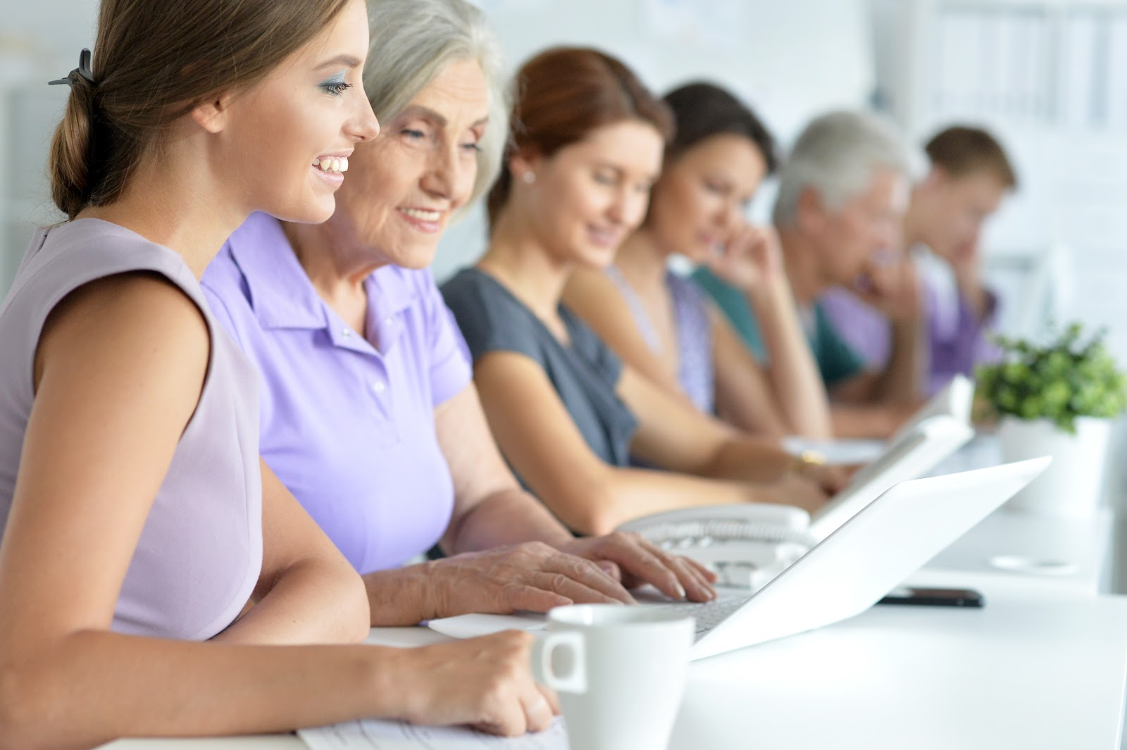 Women working at a shared desk space