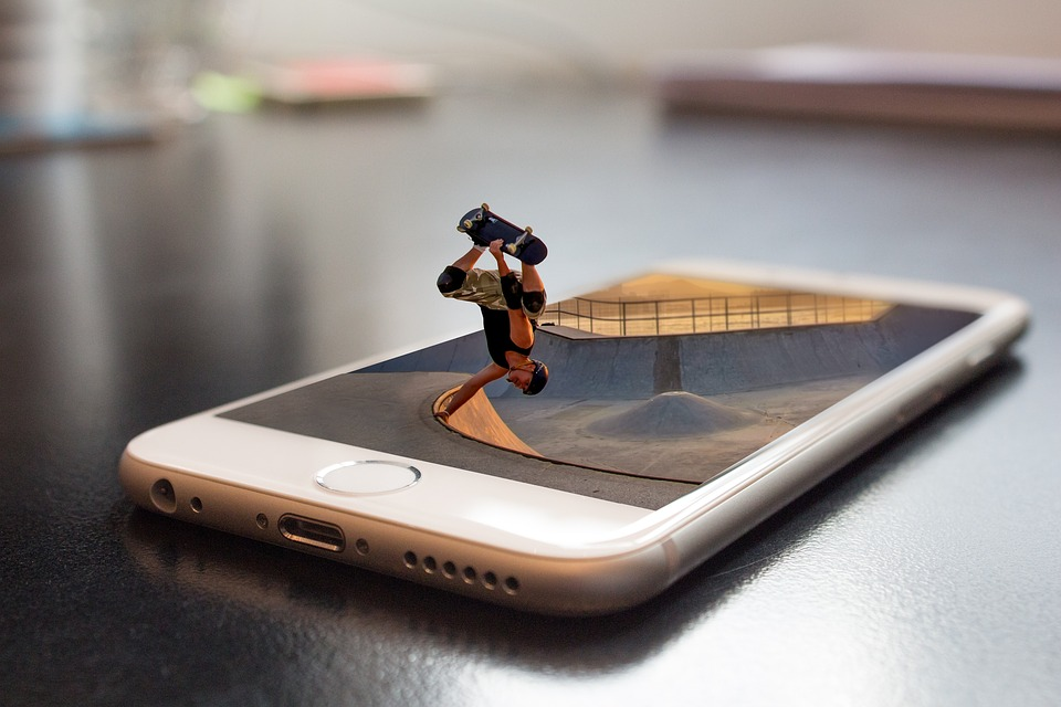 man riding skateboard out of phone