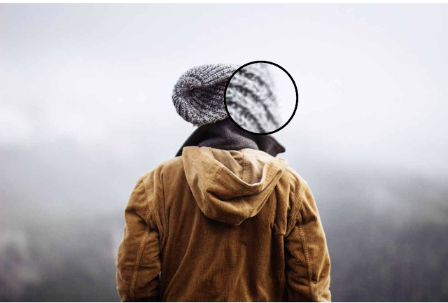 JQuery magnifier used on woman wearing jacket and beanie hat