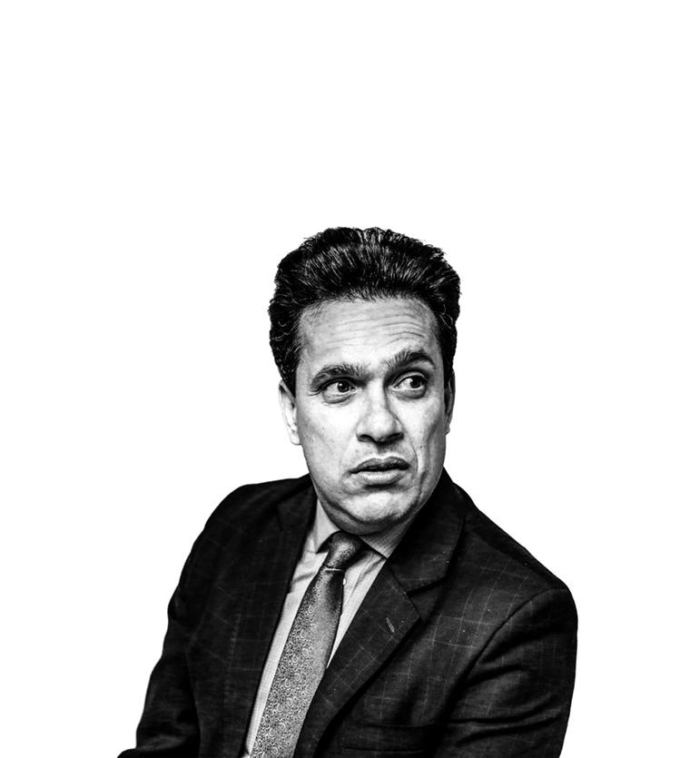 black and white studio photo of man