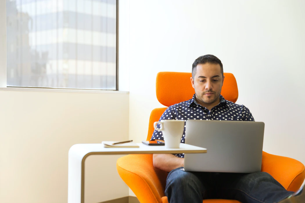 man working in front of laptop