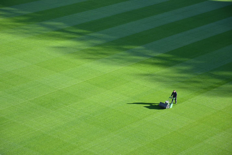 man mowing a beautiful grass field