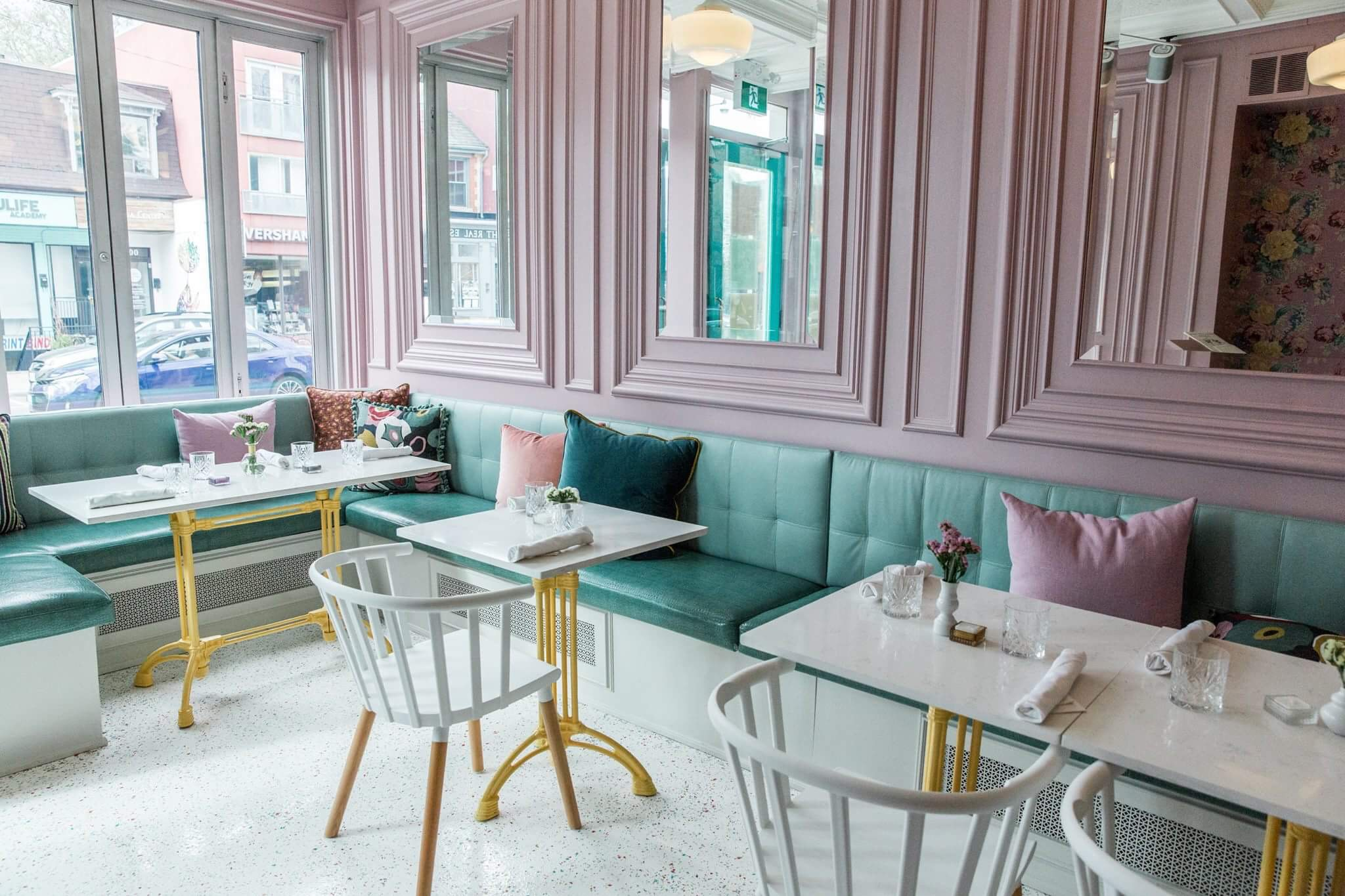 Pastel pink and green interior at the Cafe Cancan restaurant.