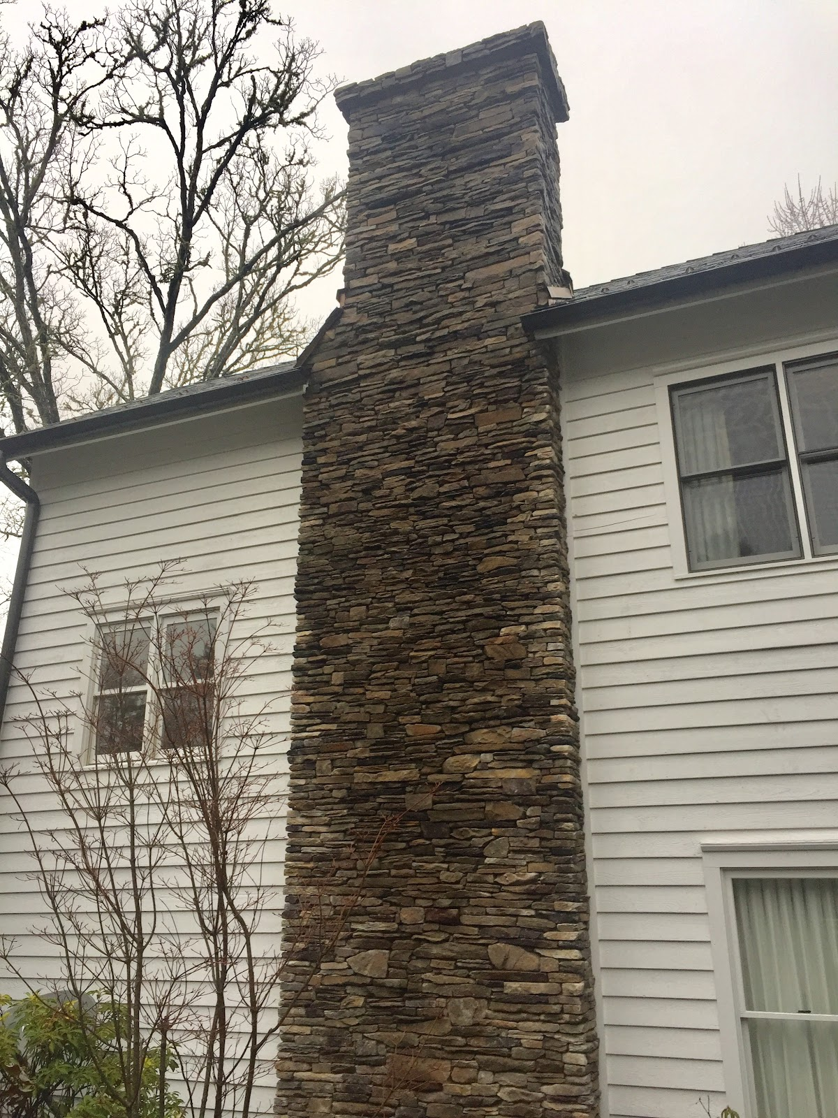 Outdoor Stone Fireplace With Chimney
