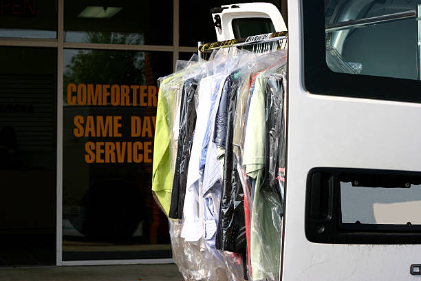 Drycleaned Delivery Drycleaned clothing hanging on van rack outside drycleaning shopSimilar: laundry delivery stock pictures, royalty-free photos & images