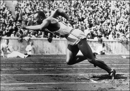 Jesse Owens wins four gold medals at the Berlin Olympics in 1936