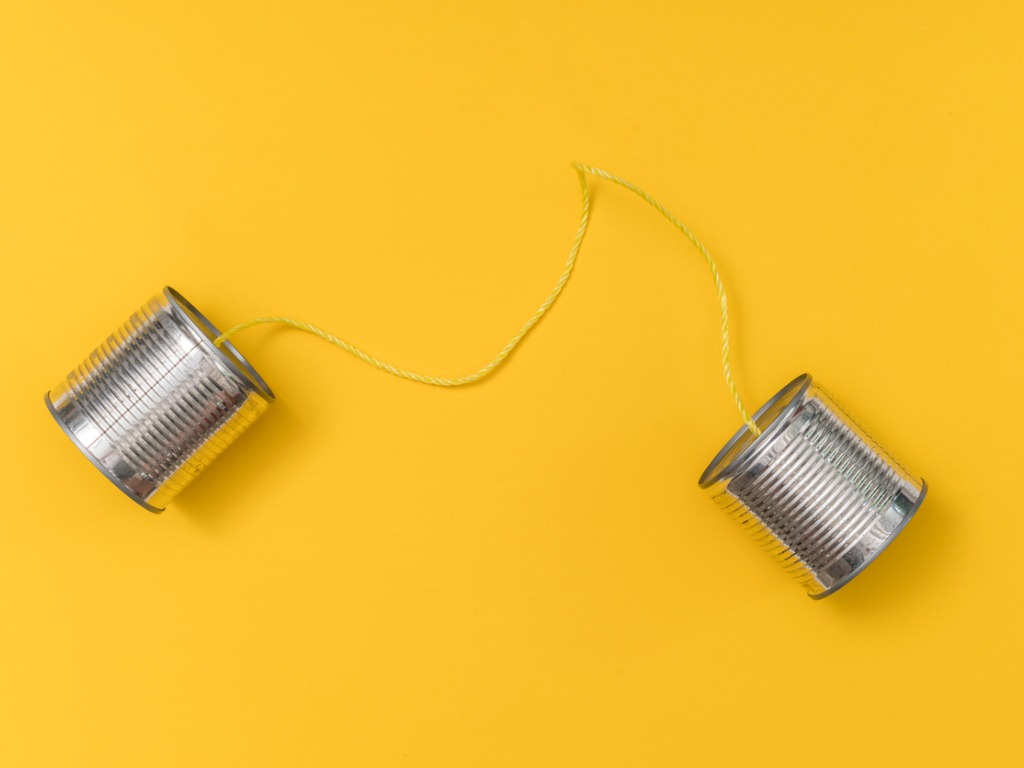 aluminum coffee cans tied together with strings