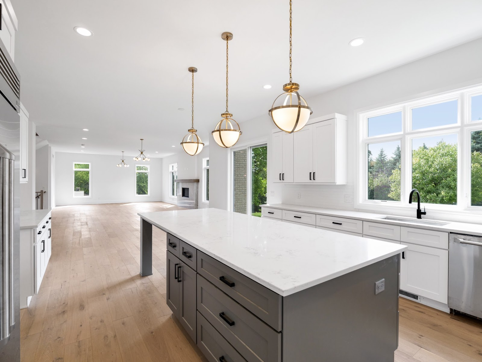 large kitchen with white shaker cabinets and grey shaker cabinets on the island, as well as white countertops. grey shaker cabinets are one of the best kitchen trends for 2020