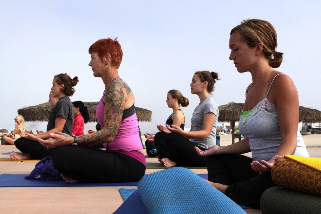 Image of women practicing meditation in yoga classes
