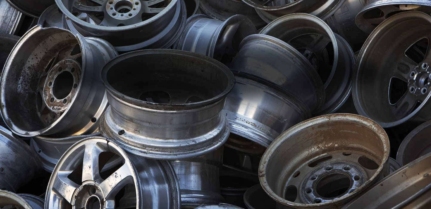 car and truck wheels in a pile