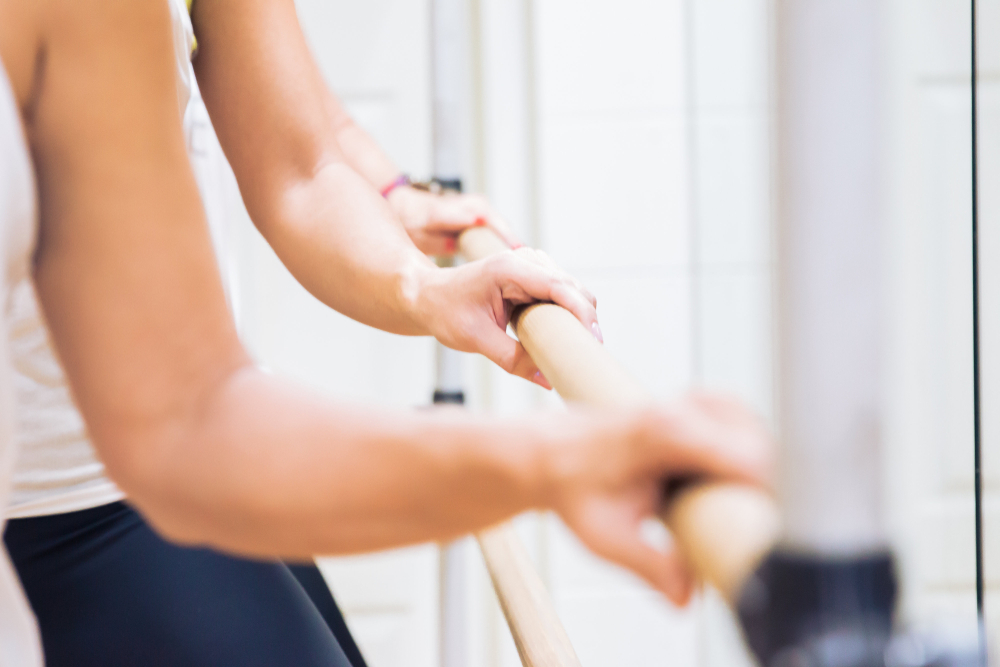 hands on the ballet barre