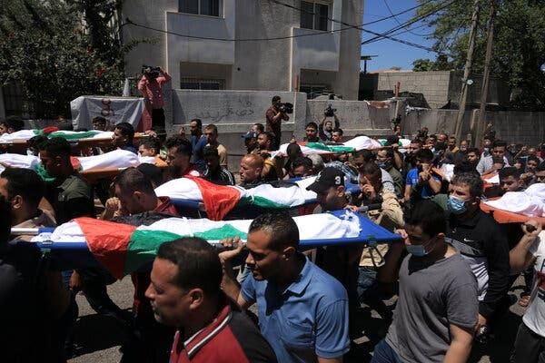 Palestinians carrying the bodies of children killed in an Israeli raid Saturday night in Gaza.