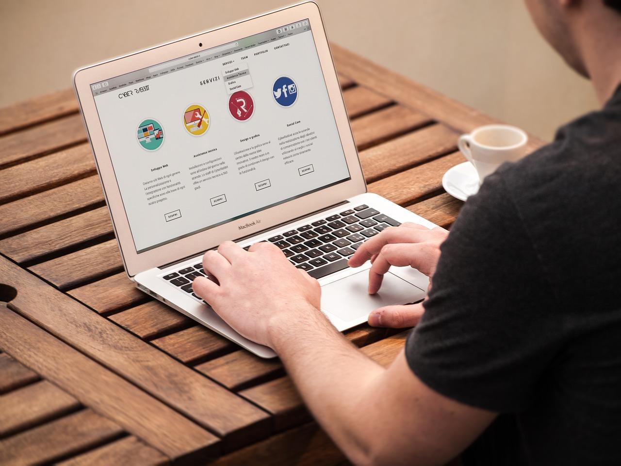 A man visiting a website on a laptop