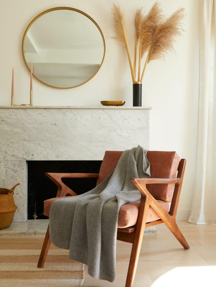 brown wooden chair beside gray textile