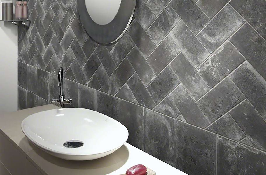gray subway tile in herringbone pattern on wall