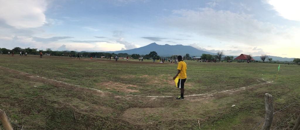 Mombacho Volcano cycling climb - soccer field in Granada with referee