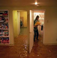 A lady cleaning up her flooded basement