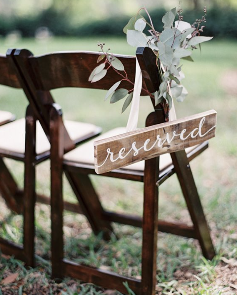 painted wooden reserved sign
