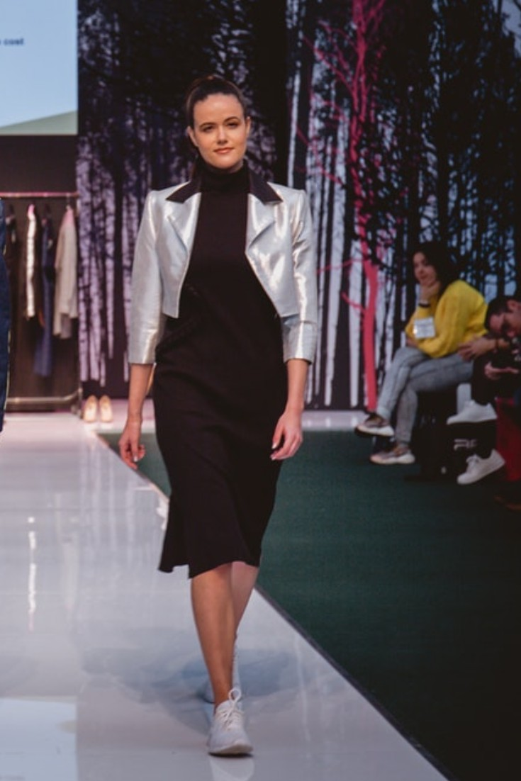 SEO Alt Text: Model Amanda Sarco Styled By Roberta Lee, Pure London Runway Feb 2020 | Conscious Fashion Brands | Black Dress, White Trainers, Silver Jacket