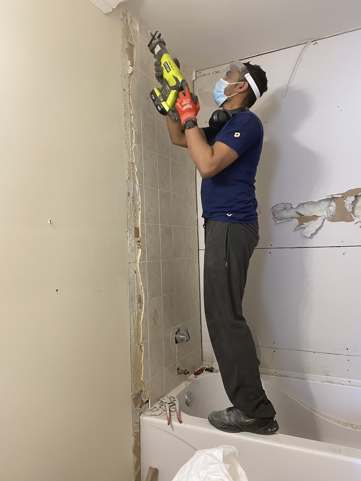 Cut out the wall but don't hit the studs to remove shower tiles