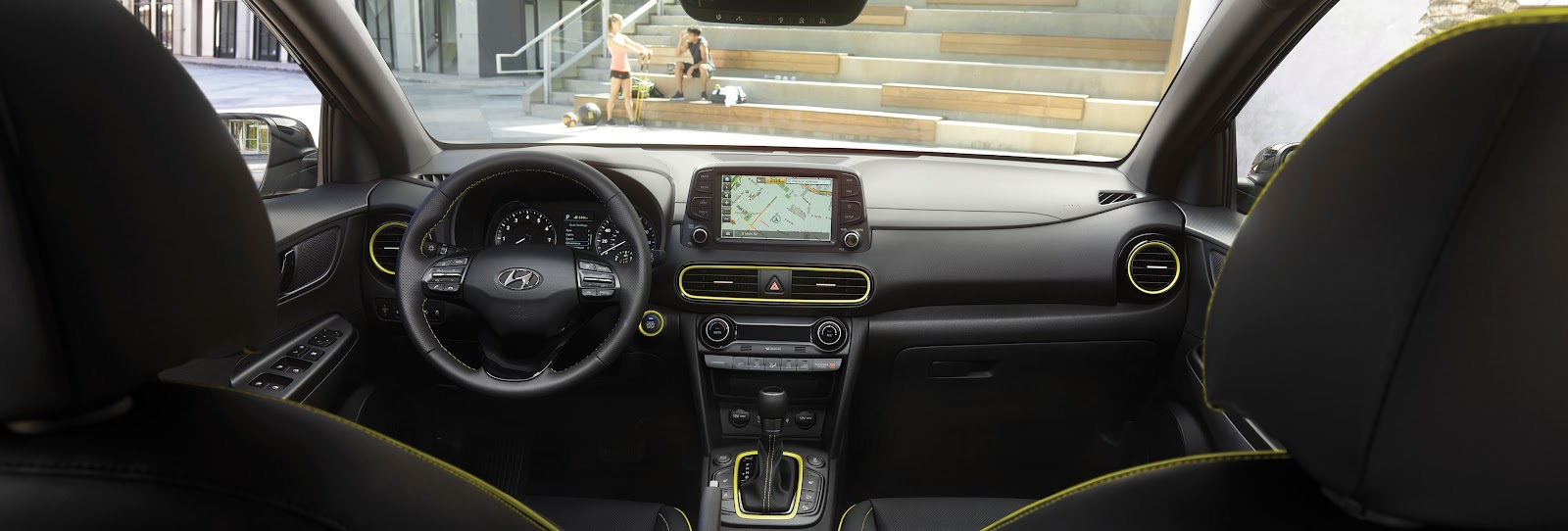 A wide shot of the Kona's interior with bright yellow embellishments