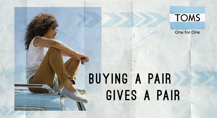 "A TOMS shoes 'One for One' ad campaign with a woman sitting on a car and the message ""Buying a pair gives a pair""."
