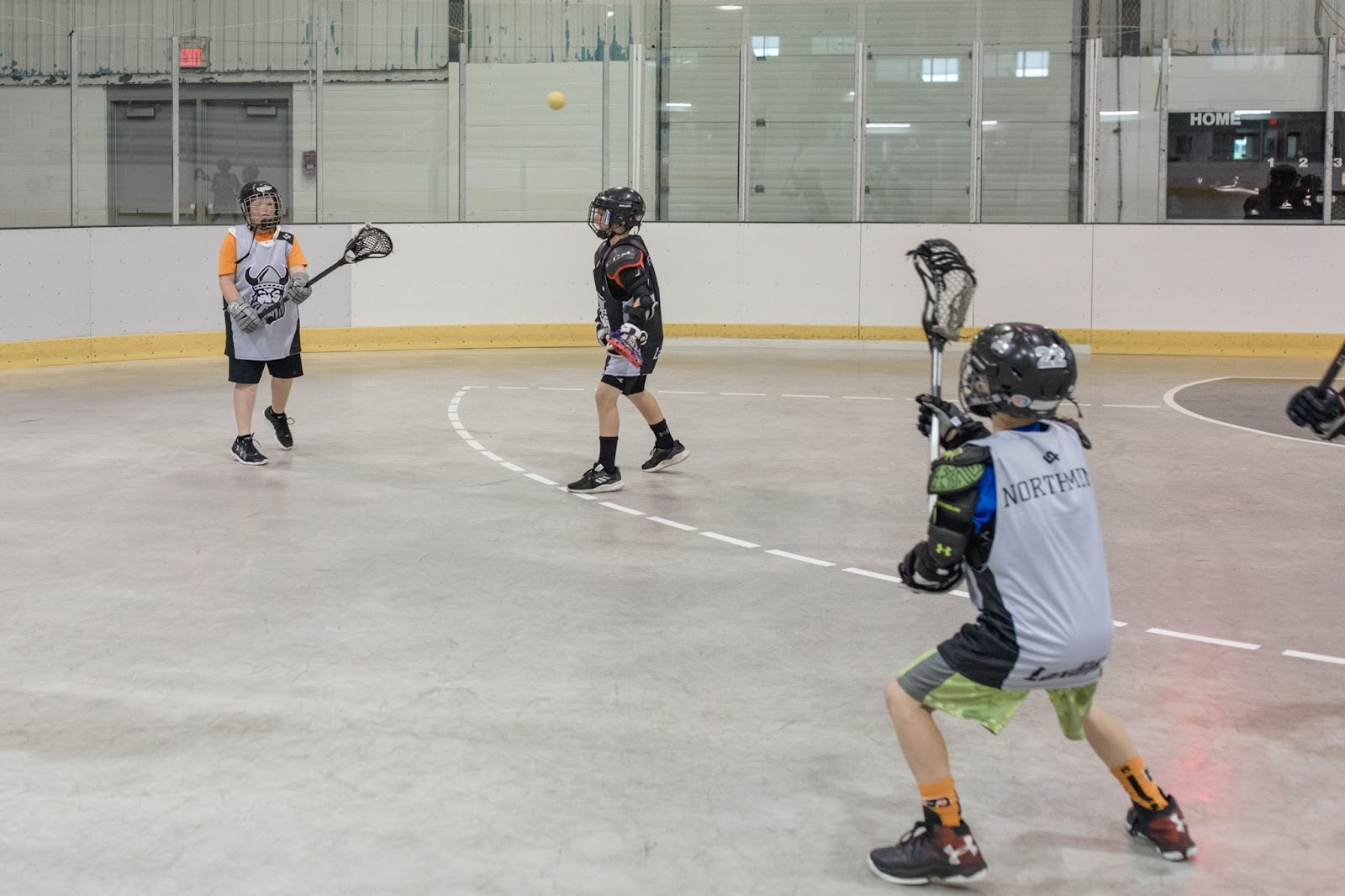 Players participating in a 3 vs. 3 small-sided game at an Orangeville Laxlife Camp