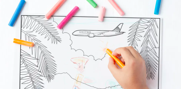 Child coloring a United plane