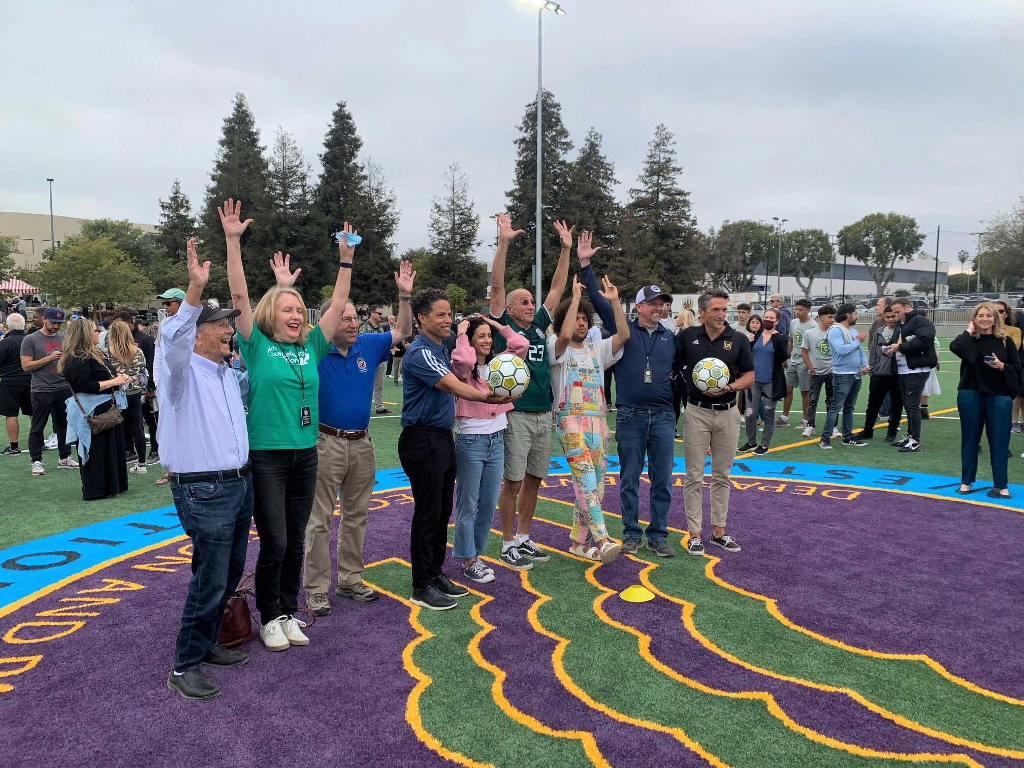 Participants celebrate opening of new soccer field at Westwood Recreation Center