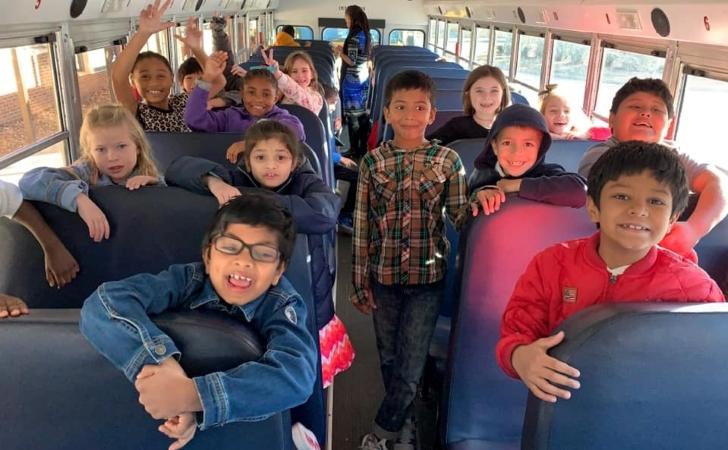 Teasley Elementary students on a school bus in Smyrna, GA.