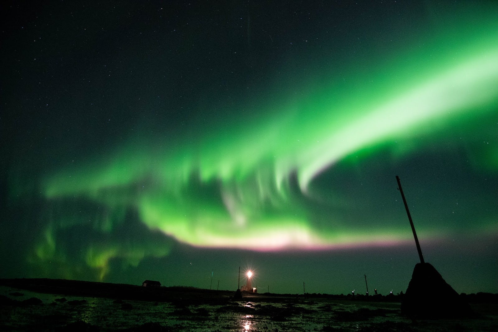A powerful Northern Lights display over Grotta Lighthouse on the edge of Seltjarnarness peninsula