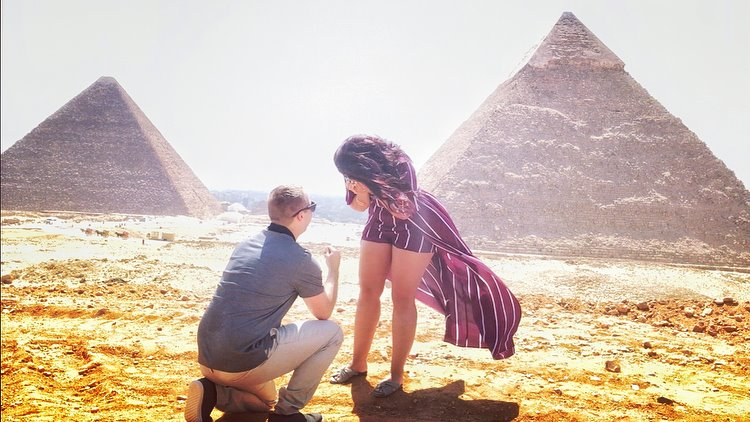 Boy proposing to Girl in front of the pyramids of Giza