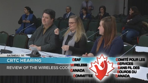 Photo description: DWCC Chairperson Lisa Anderson-Kellett presents while presentation panelists Jeffrey Beatty, Technical Consultant, and Nicole Marsh, Data Analyst look on, all three seated at a table facing CRTC Commissioners in the Wireless Code public hearing on February 6, 2017.