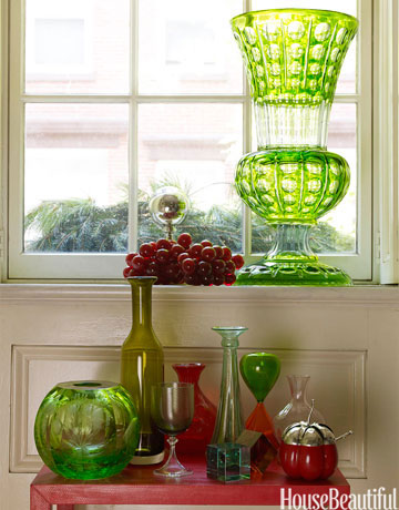 window and table with red and green vases
