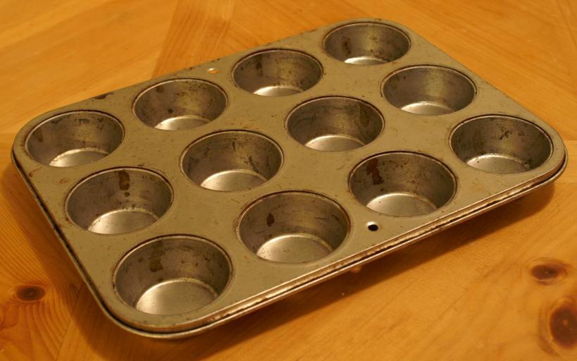 muffin tin dispenser for a mentally challenging game