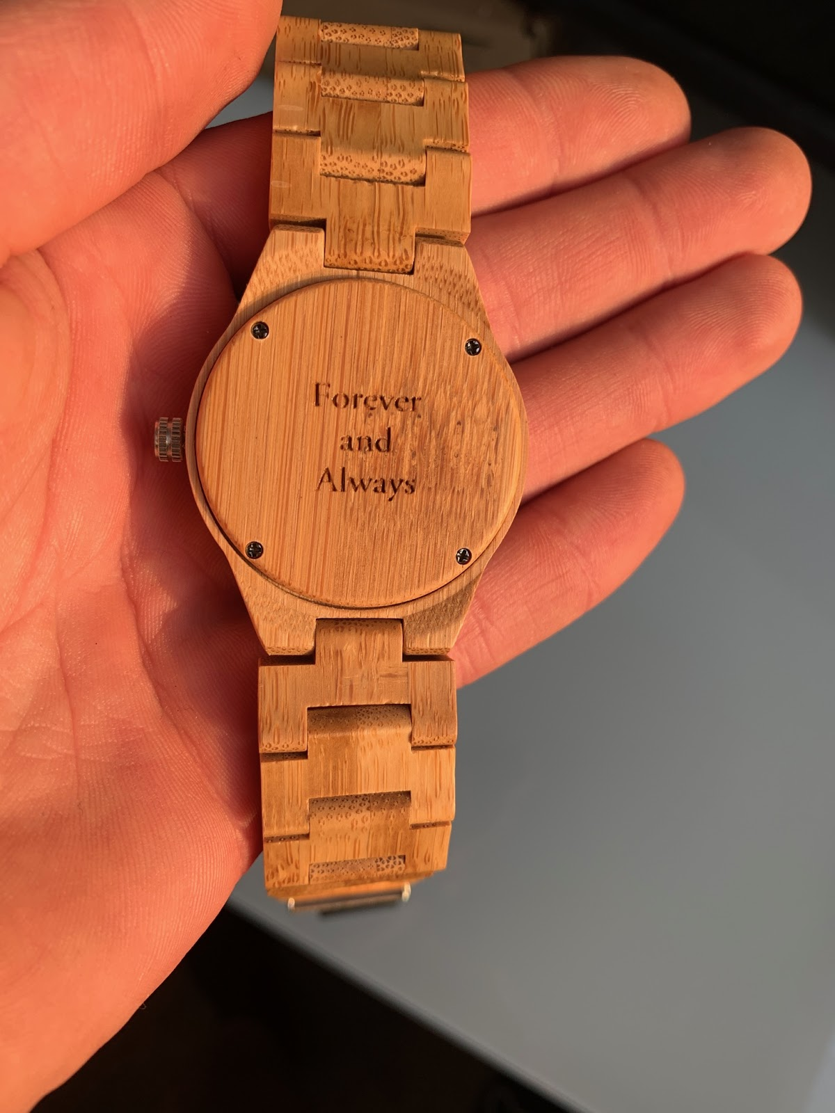 Wooden watch engraved with a quote saying Forever and Always.
