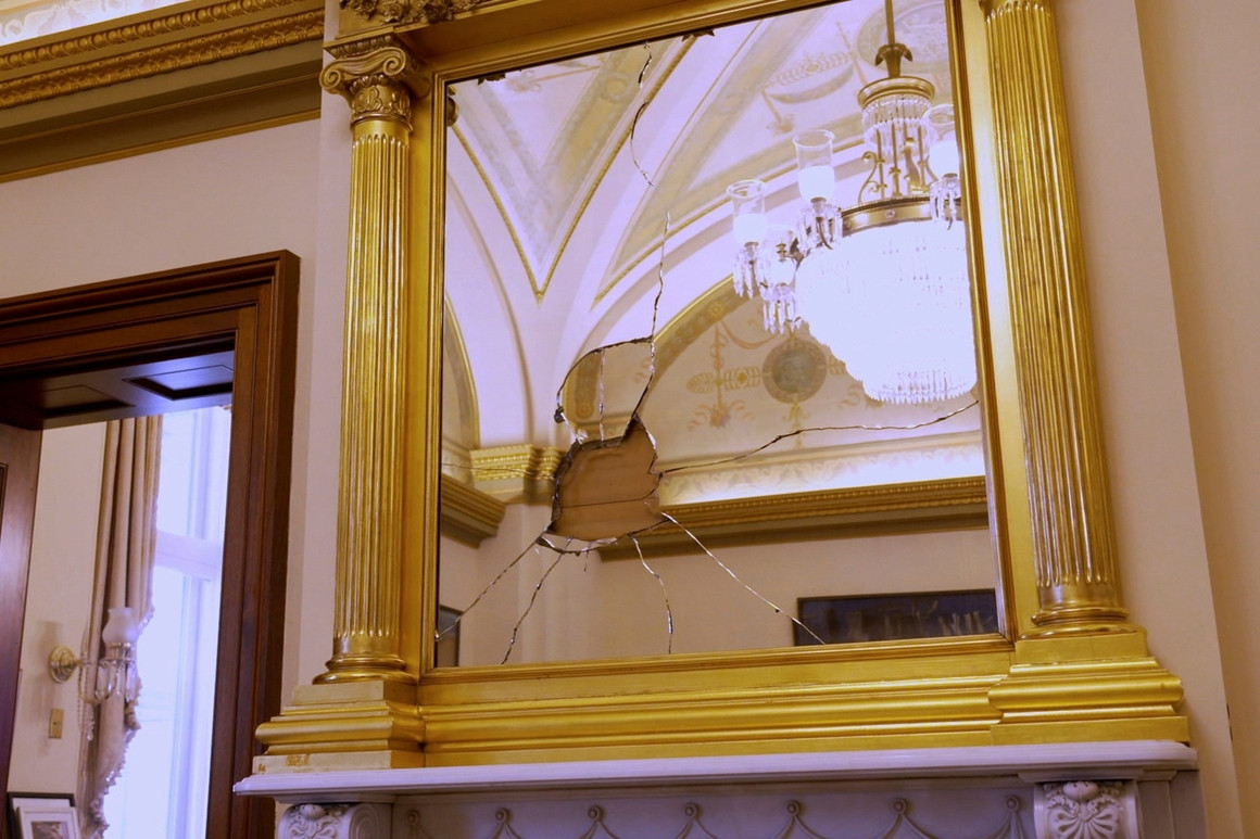 A smashed mirror is seen in Nancy Pelosi's office