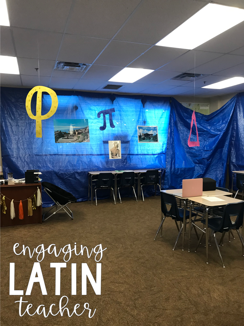 Desks and chairs set up as tables with pictures and symbols of Latin displayed